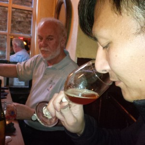 Zok samples homebrew with Pinch's James Tai.